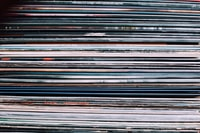 A background consisting of a stack of records in the city of Nancy, France