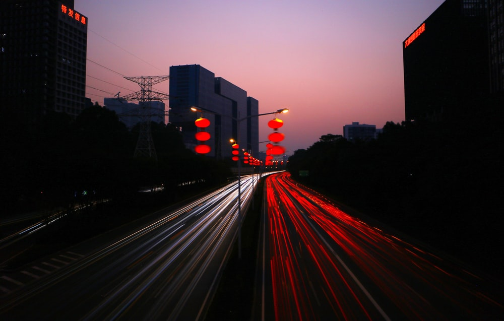 timelapes photography of car lights on road during night time