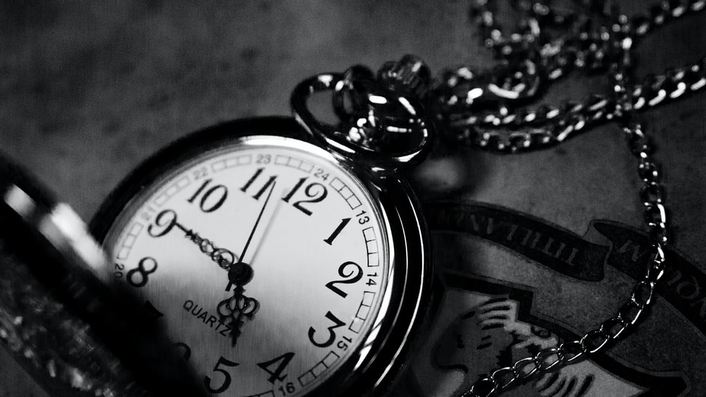 A black-and-white shot of a pocket watch