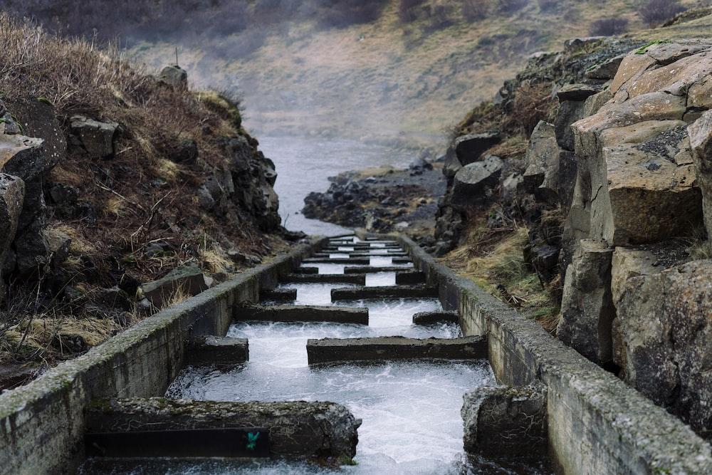 water dam between gray rock formation