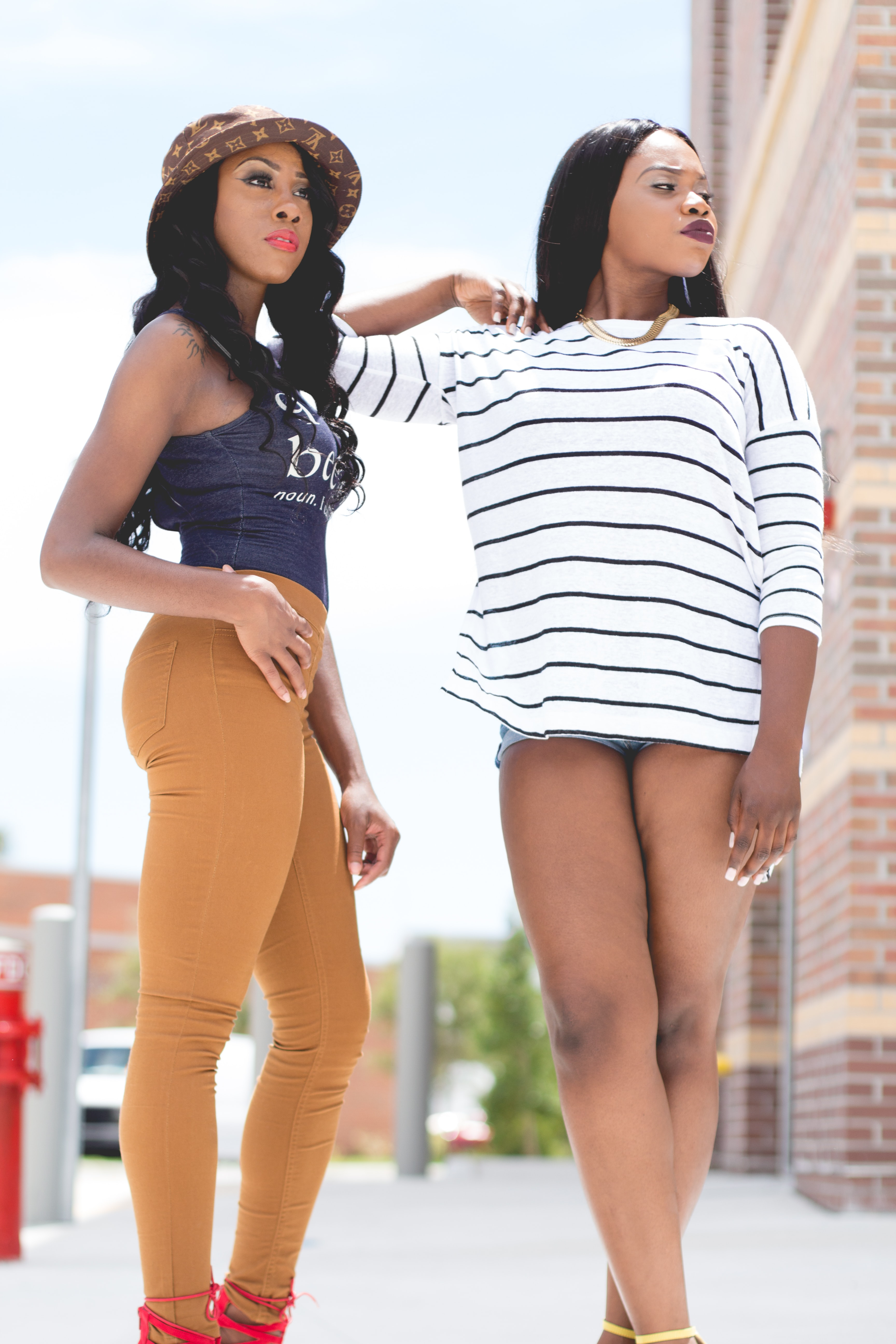 Woman in trendy casual summer outfits pose confidently