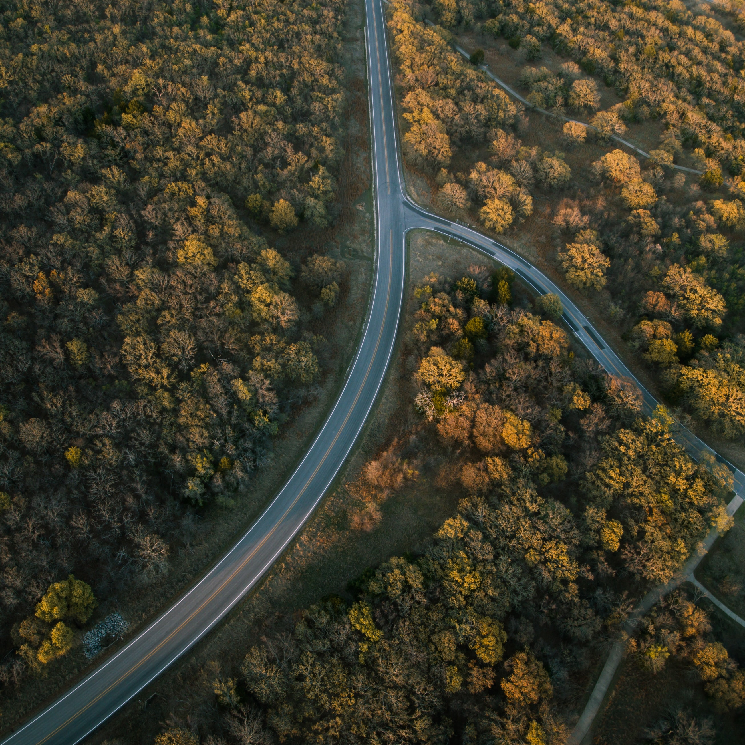 A drone shot of a bend in a road near Lake Ray Roberts