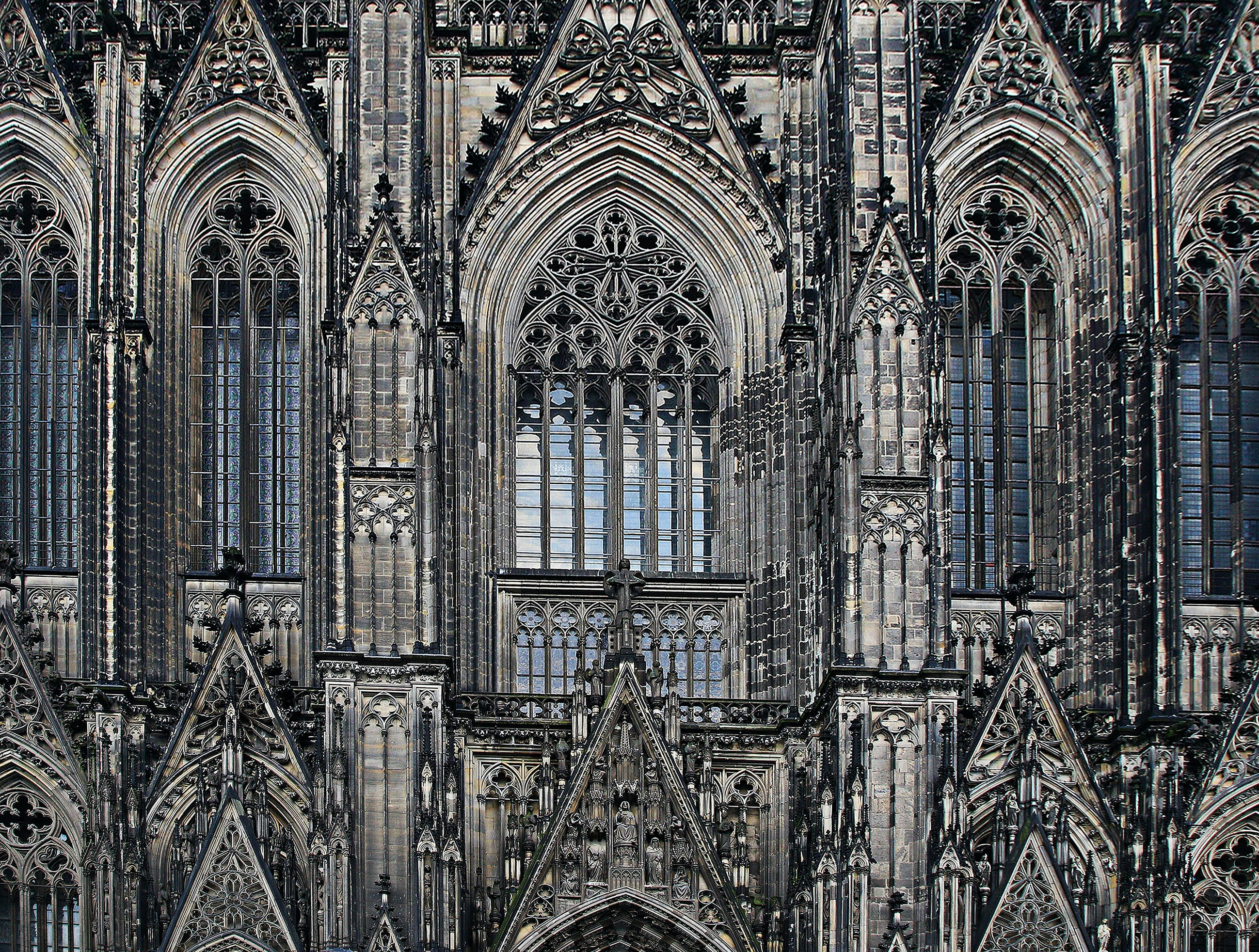 The detailed facade of an old cathedral.