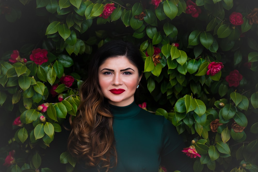 woman standing near green tree