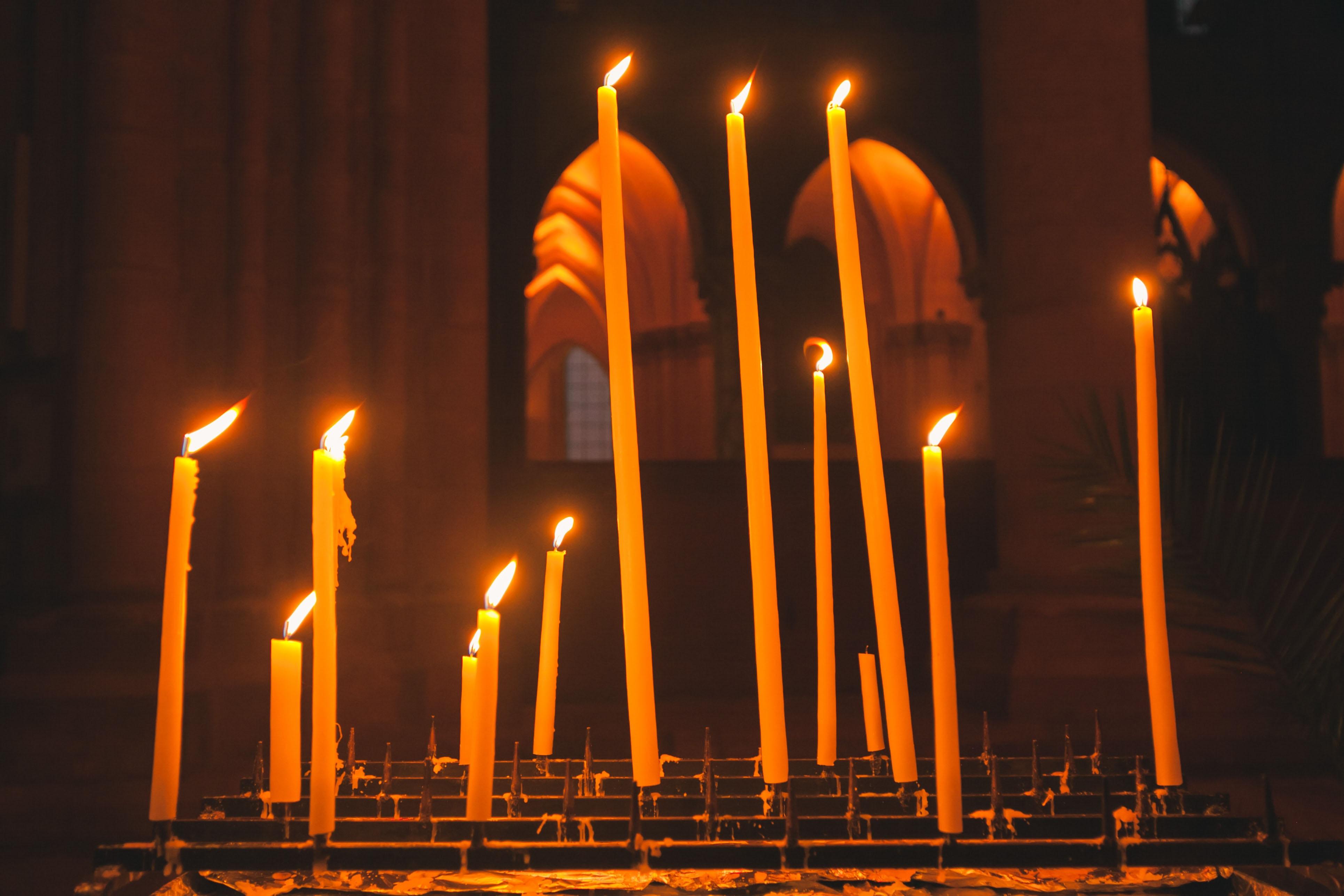 Tall candles in a church.