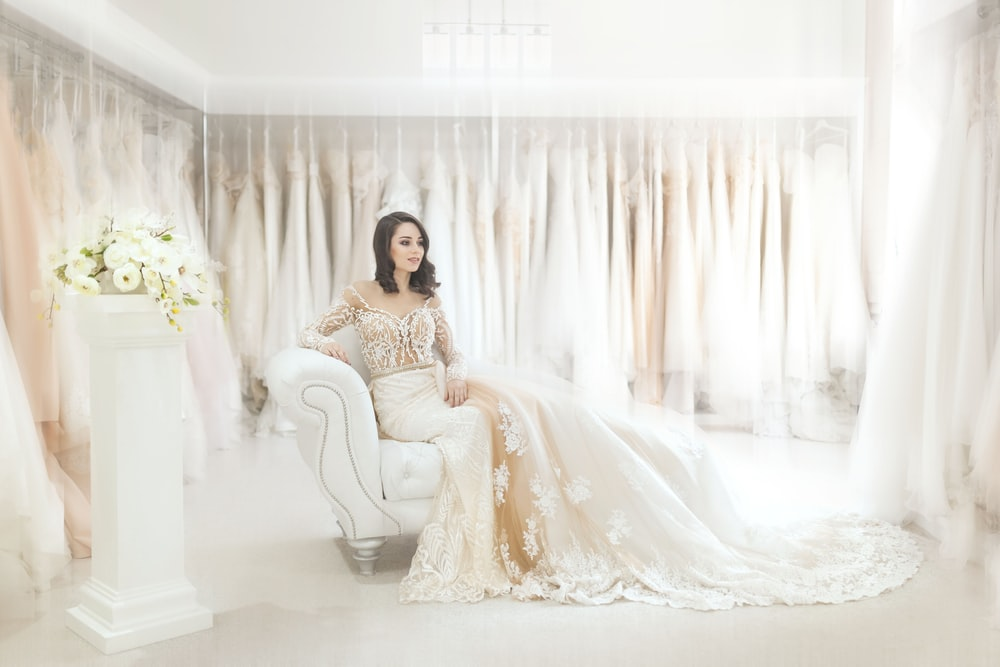 woman sitting on white leather armchair inside house