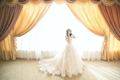Bride in front of giant window