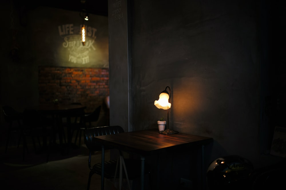 brown wooden table with table lamp
