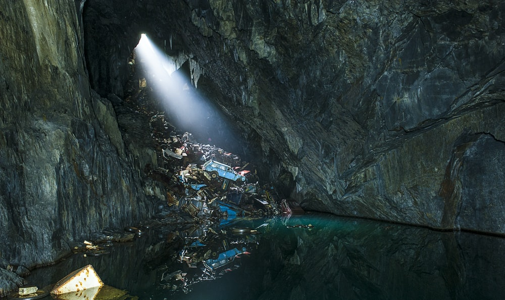 photo of body of water in cave