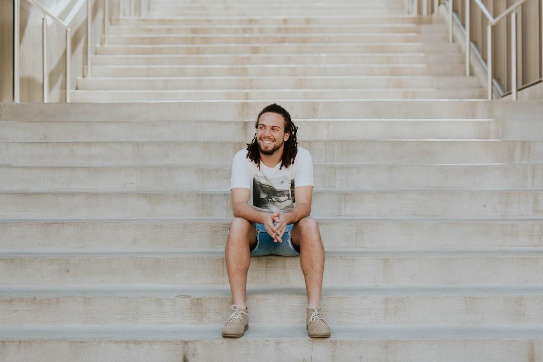 Man smiling on steps