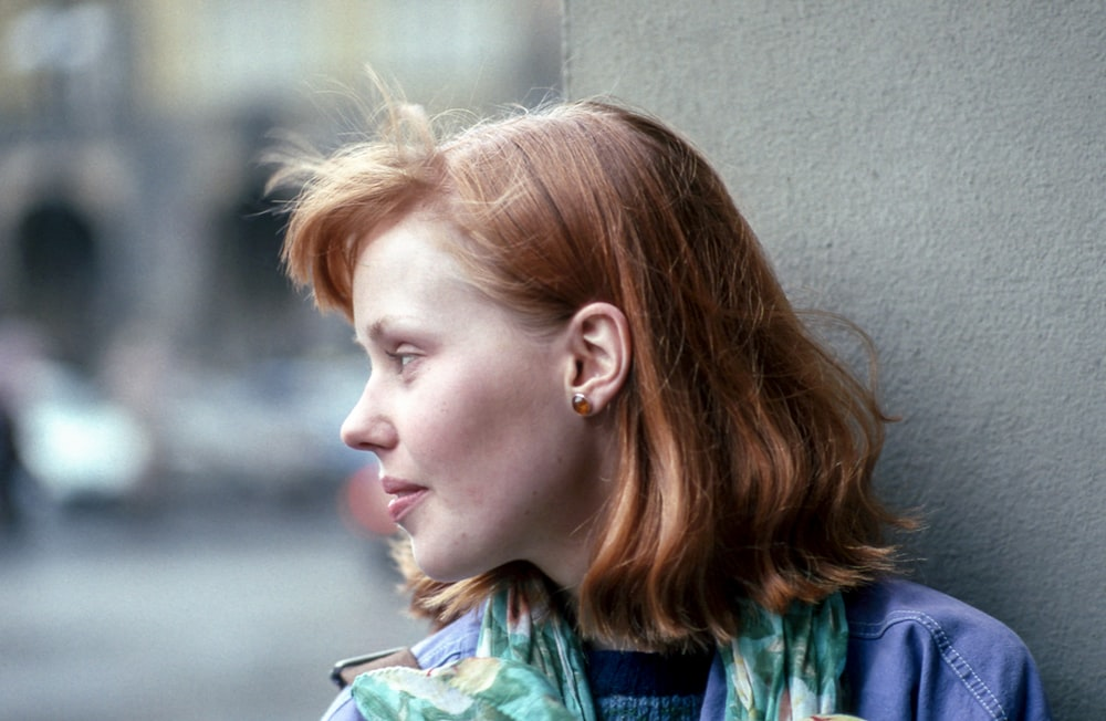 close-up photography of woman looking outside