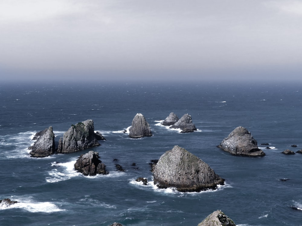 photo of islets surrounded by body of water