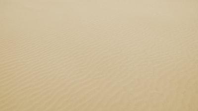 bird's eye view of desert sand zoom background