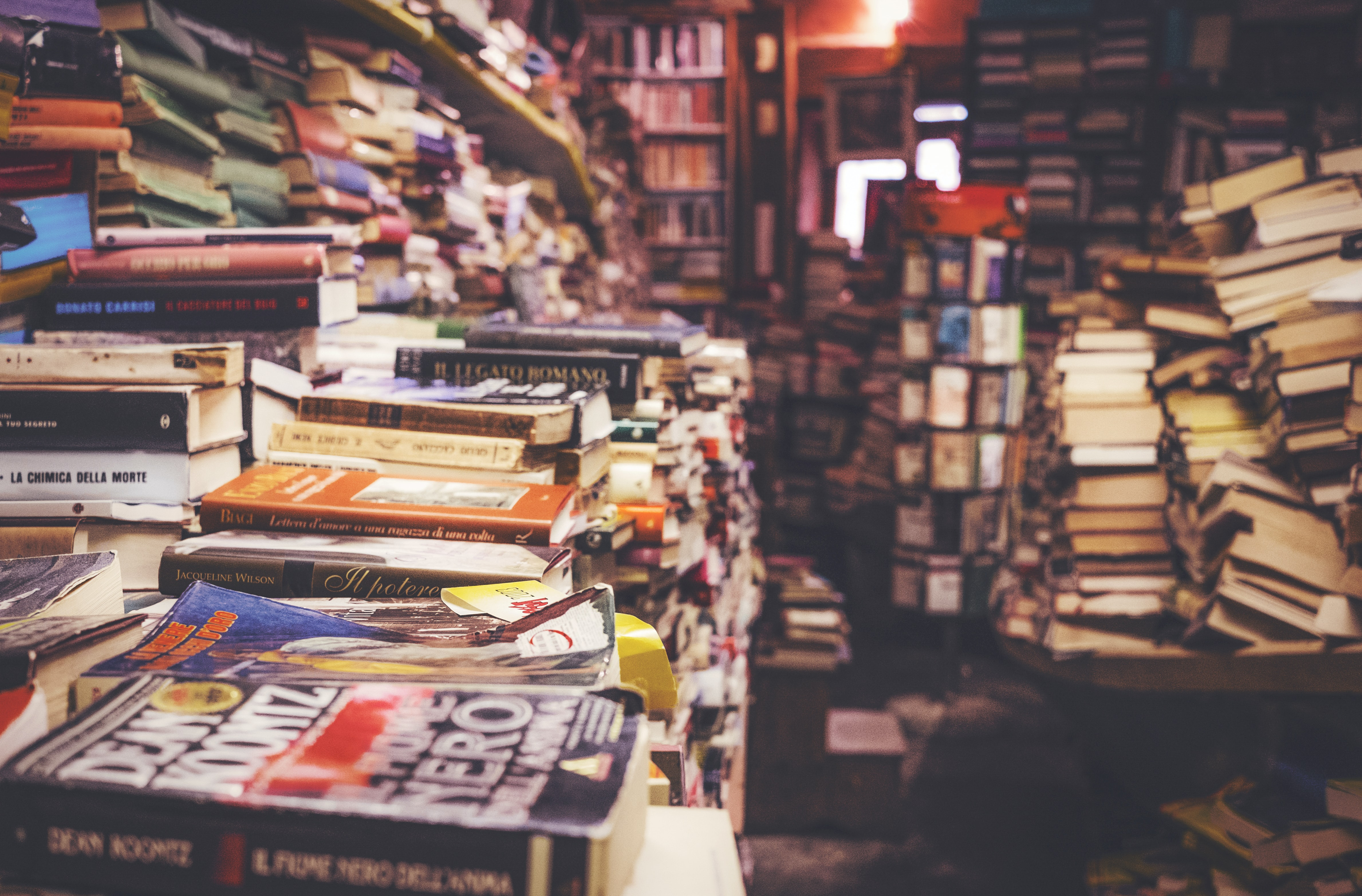 A room filled with huge stacks of books