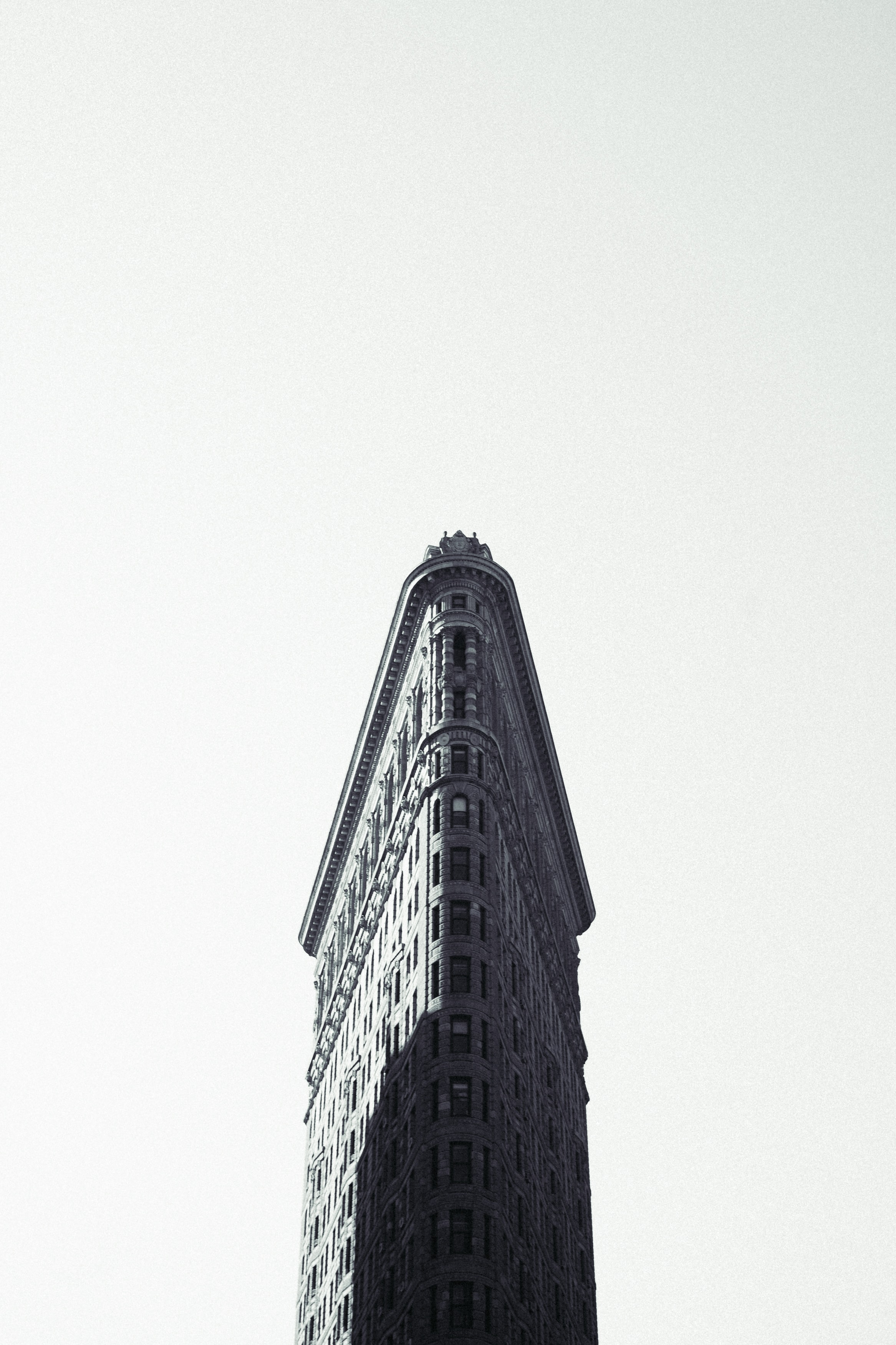 Black and white long shot of Flatiron building in New York with clear sky