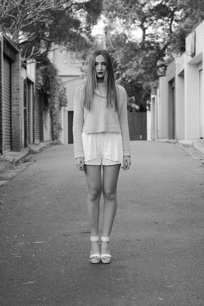 greyscale photo of woman standing