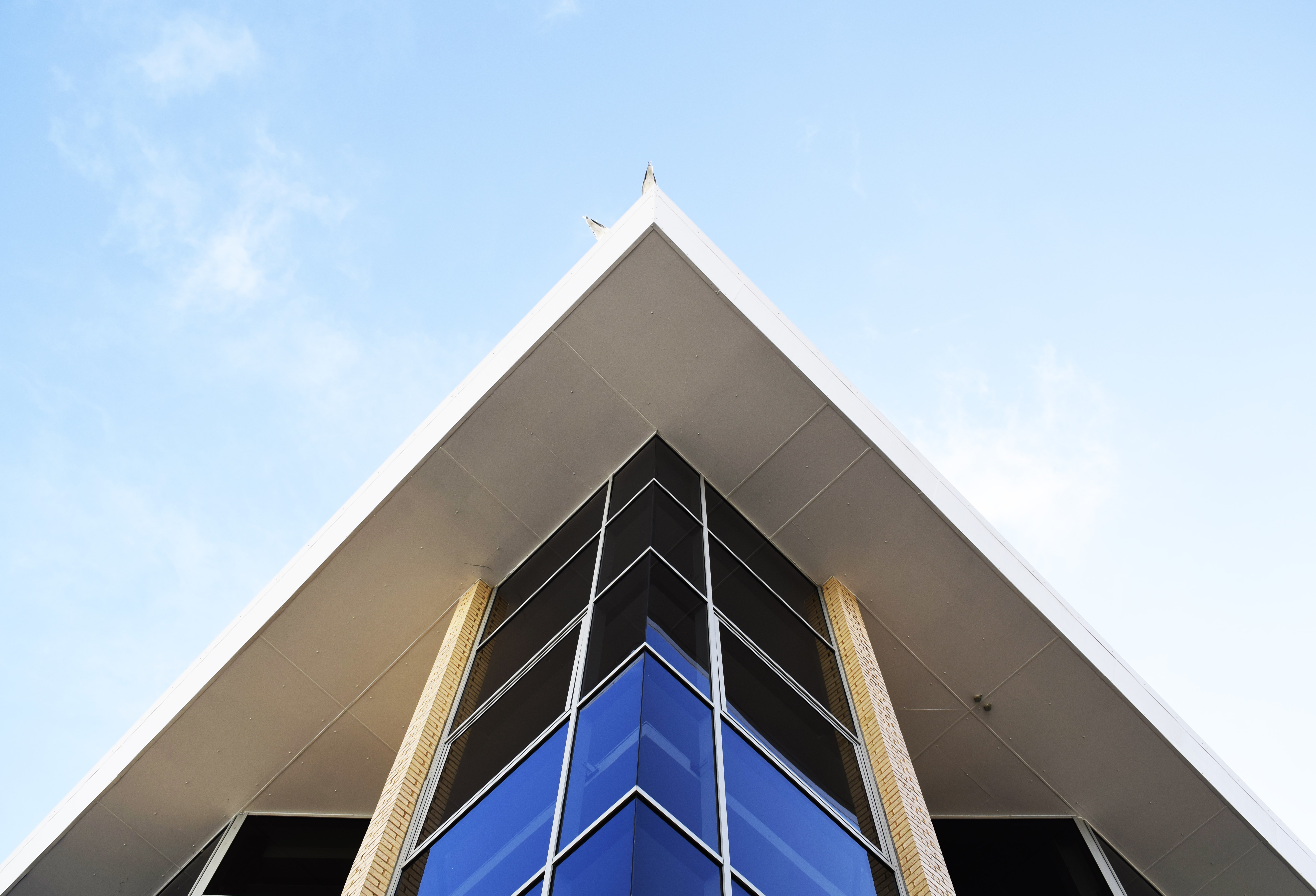 worm's eye view of building under clear blue sky
