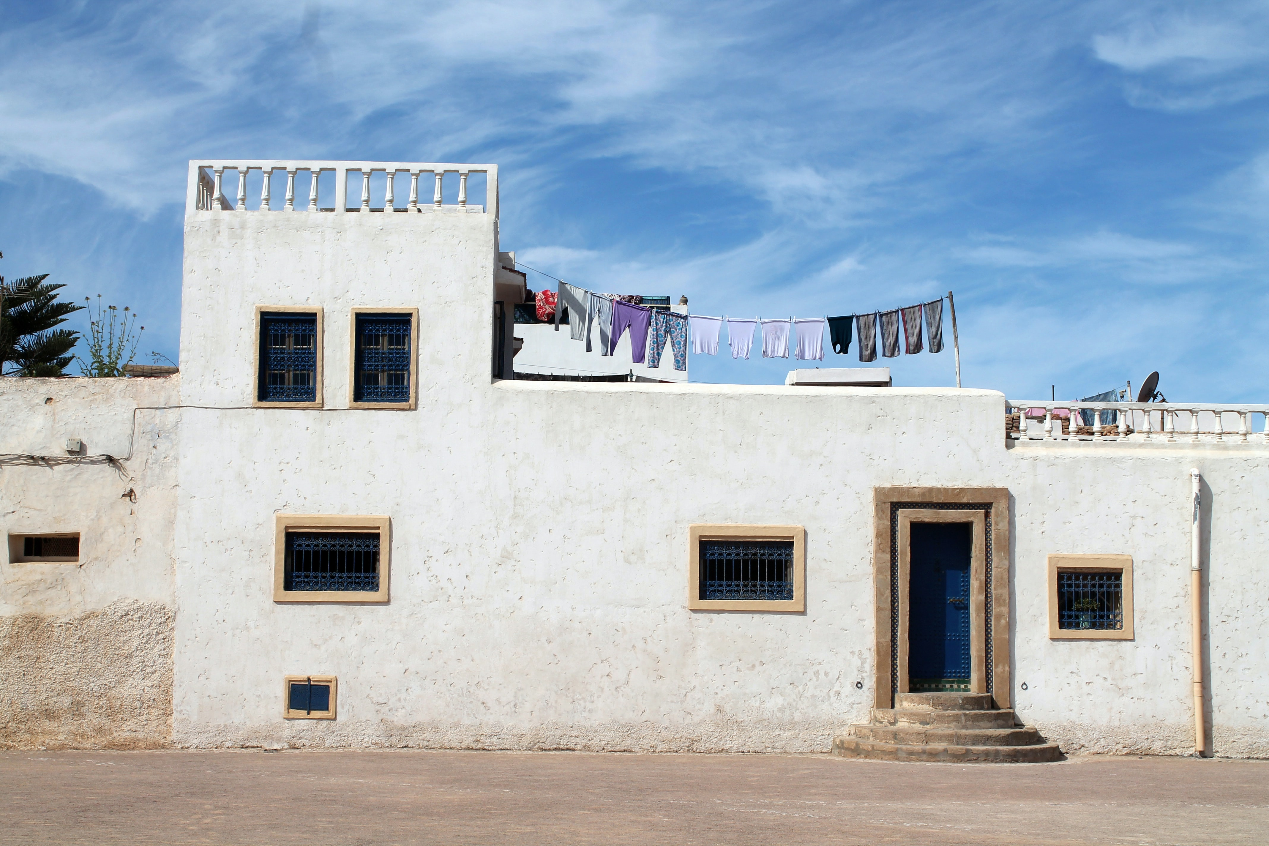 A house in Rabat Medina with clothing hanging from a rooftop clothesline