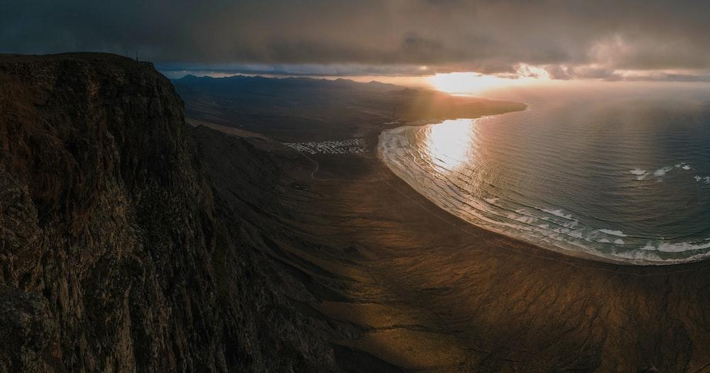 bird's eye view of seashore near cliff