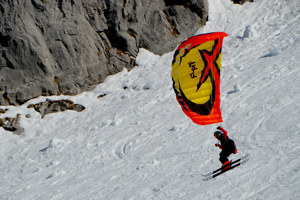 person riding parachute and ski