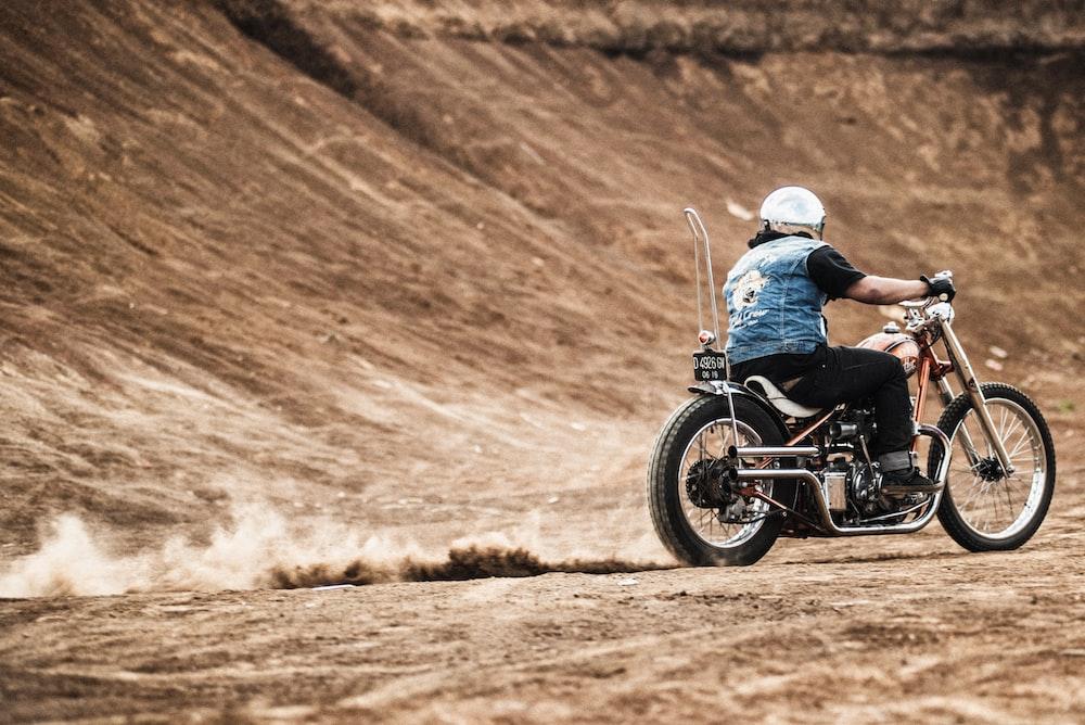 man riding on motorcycle during daytime