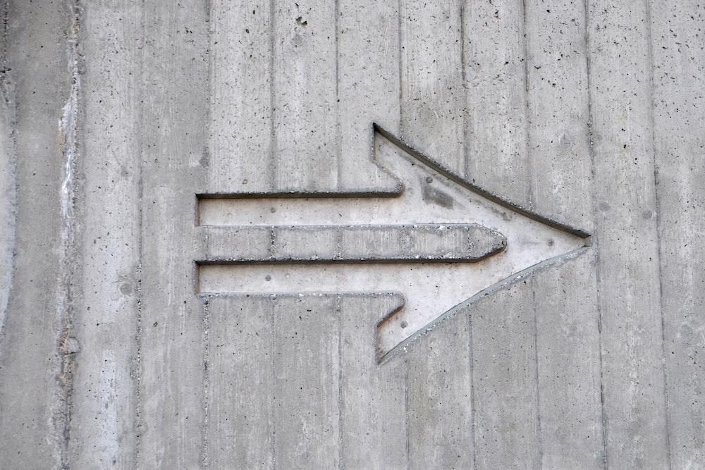 gray arrow left sign
