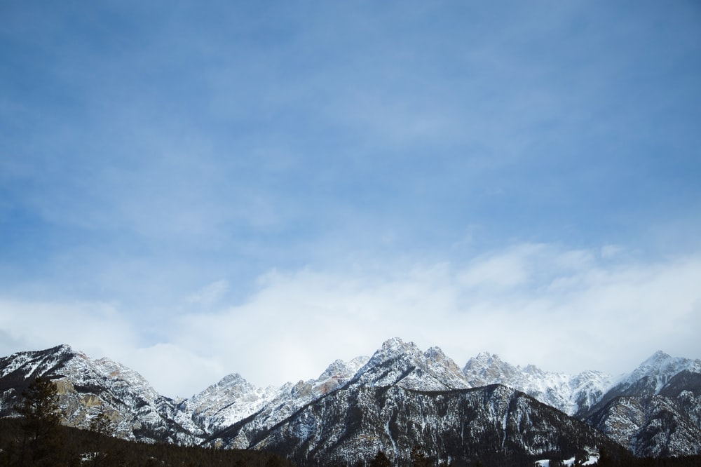 snow covered mountains under clear sky