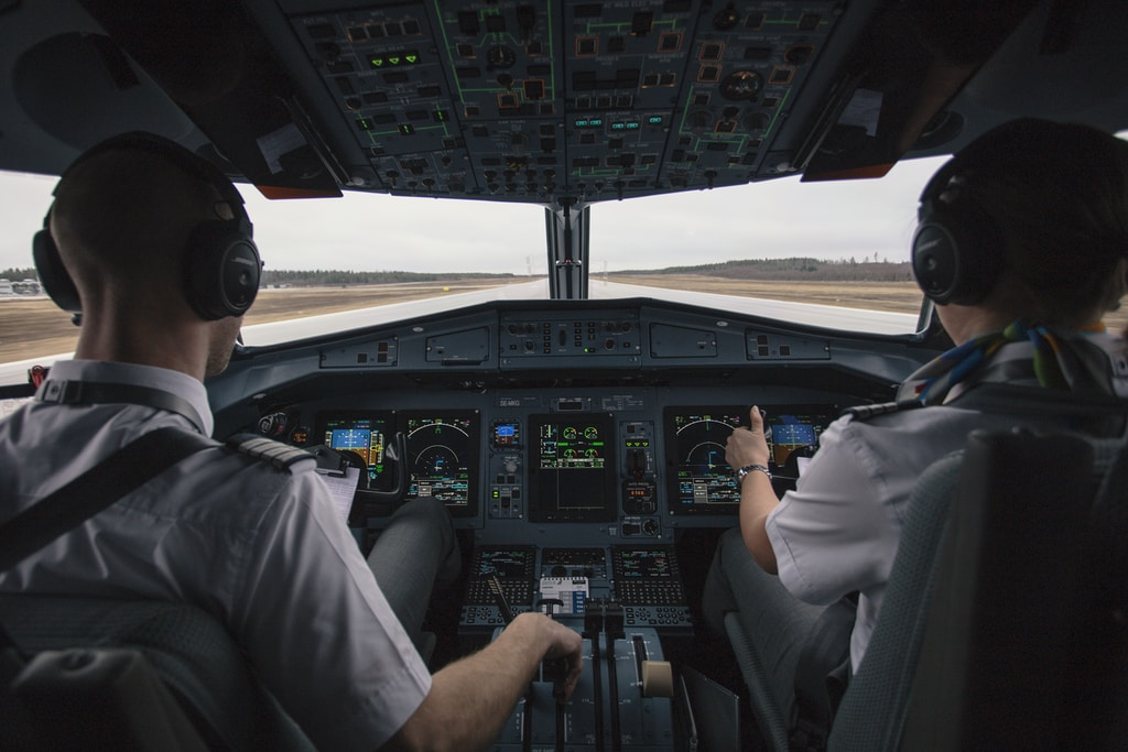 two men driving plane at daytime