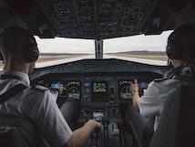 two men driving plane at daytime