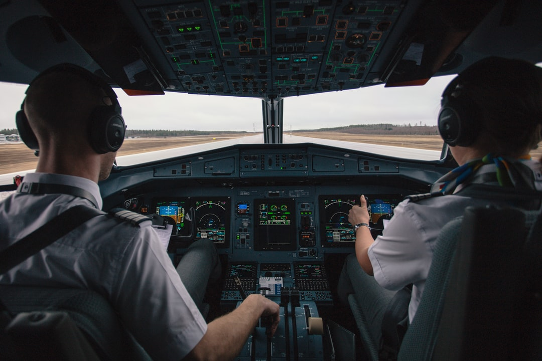 Two pilots in an airplane cockpit during take-off