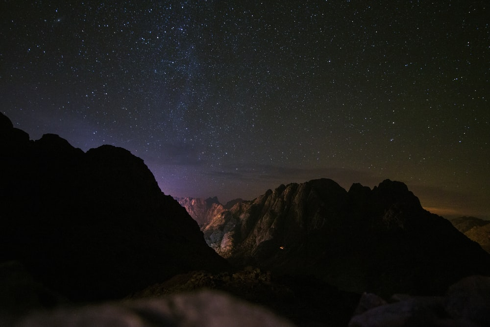 rock mountain during nighttime