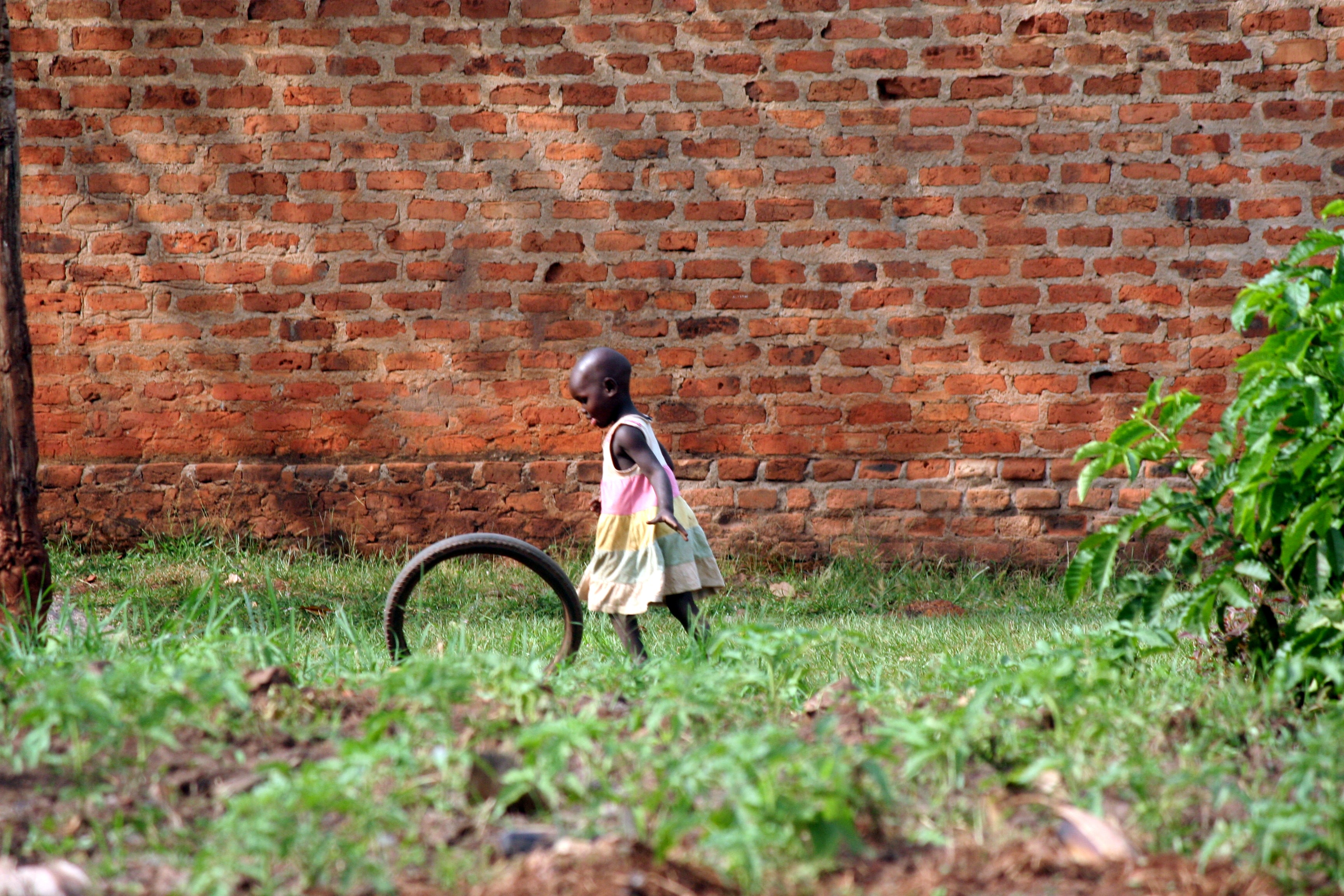 girl playing bike wheel