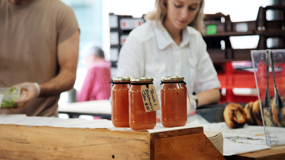 photo of three clear glass mason jars