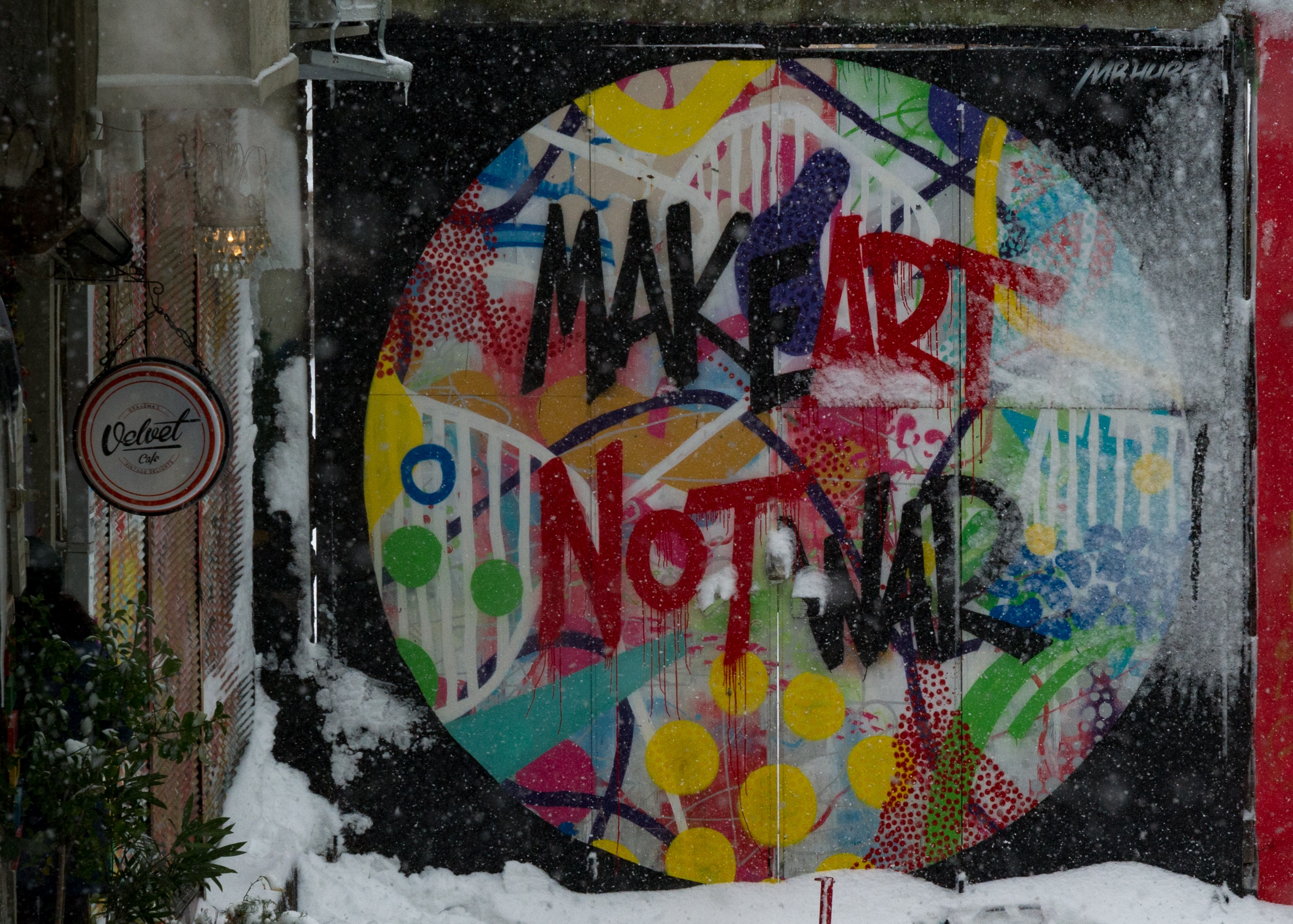 Make art not war colorful graffiti message on urban wall in Istanbul