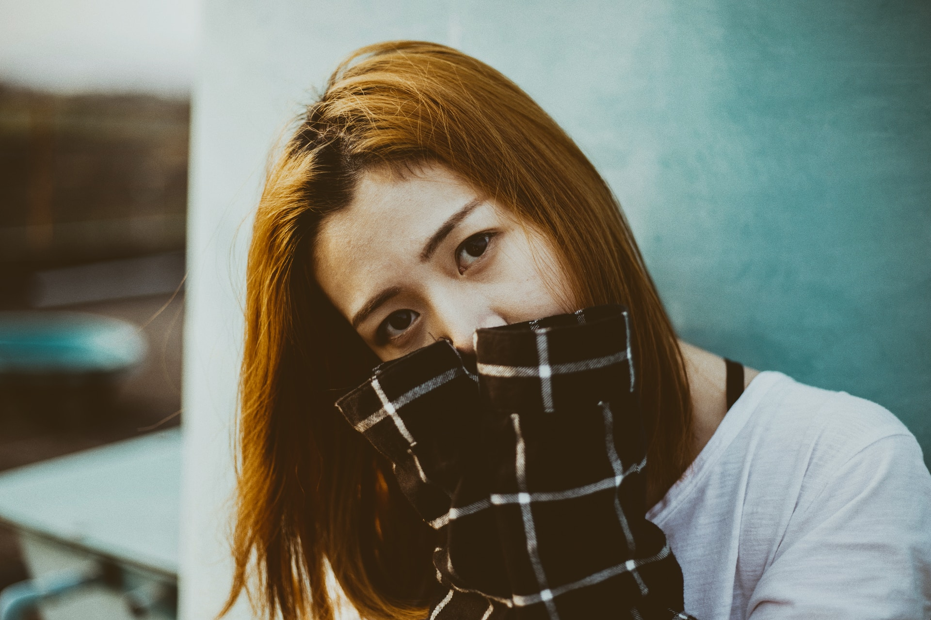 woman hiding her mouth with her hands