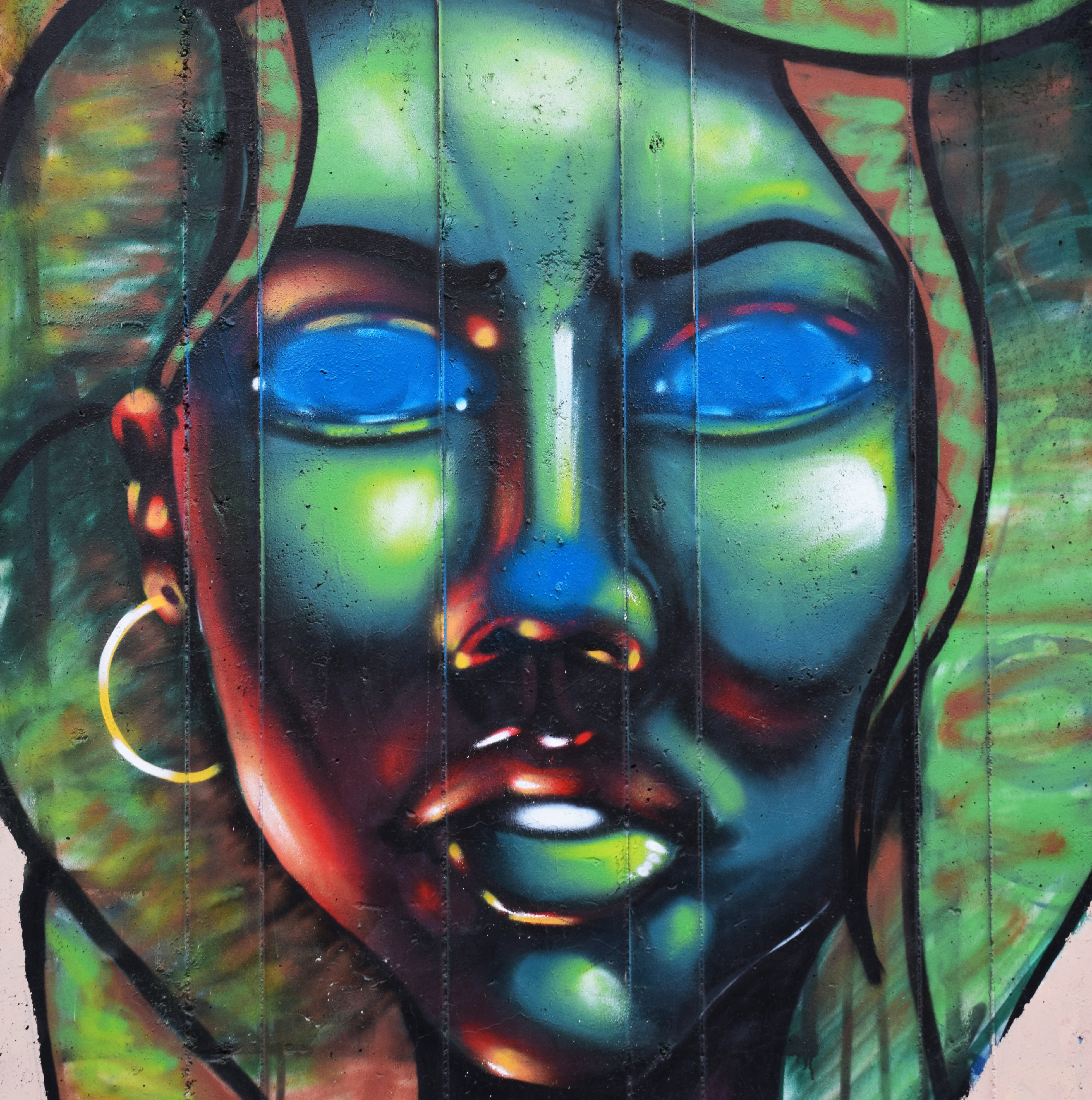 A freaky woman painted on a wall.
