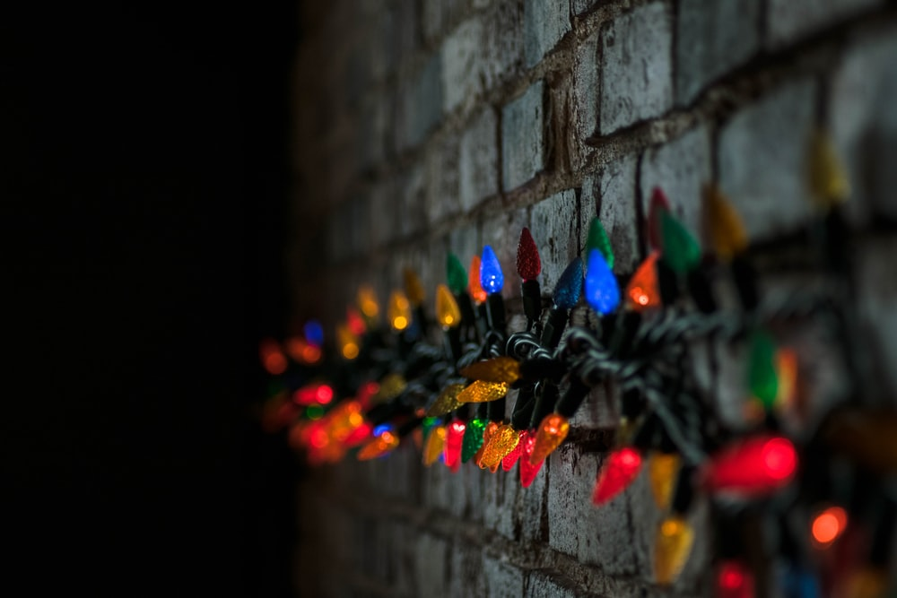 shallow focus photography of string lights at the wall