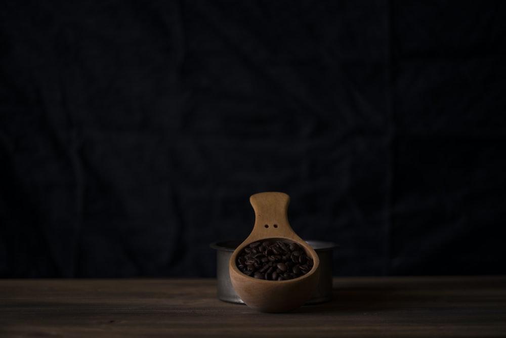 beige wooden scoop beside gray stainless steel container