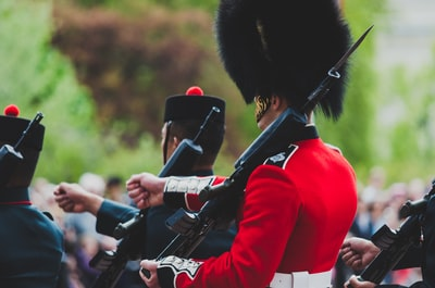 photography of royal guard marching bagpipe teams background