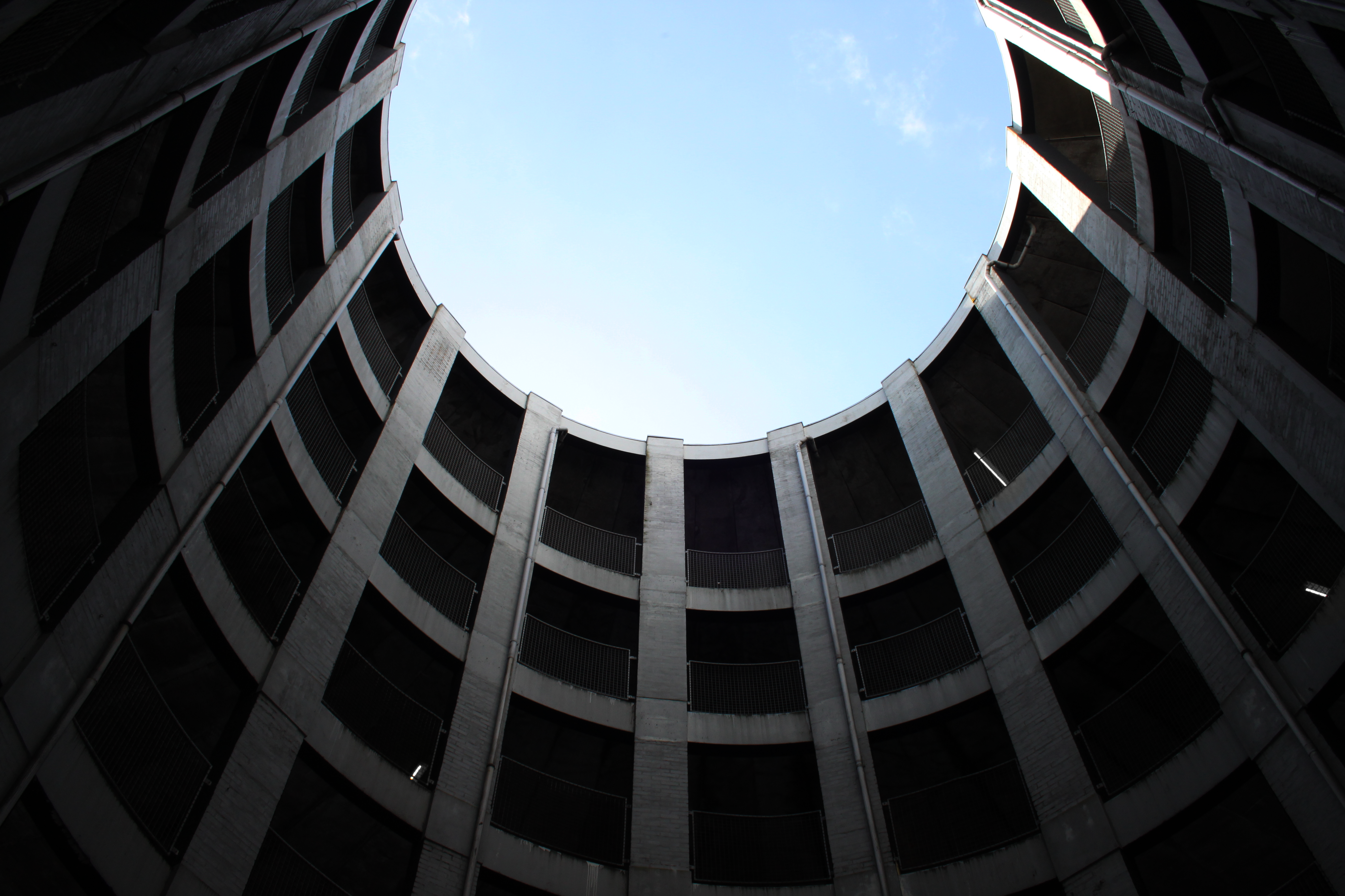 worm's eye view of building with hole on top