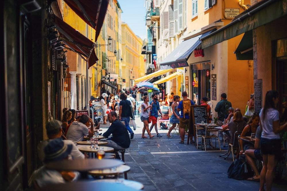 people on alleyway during daytime