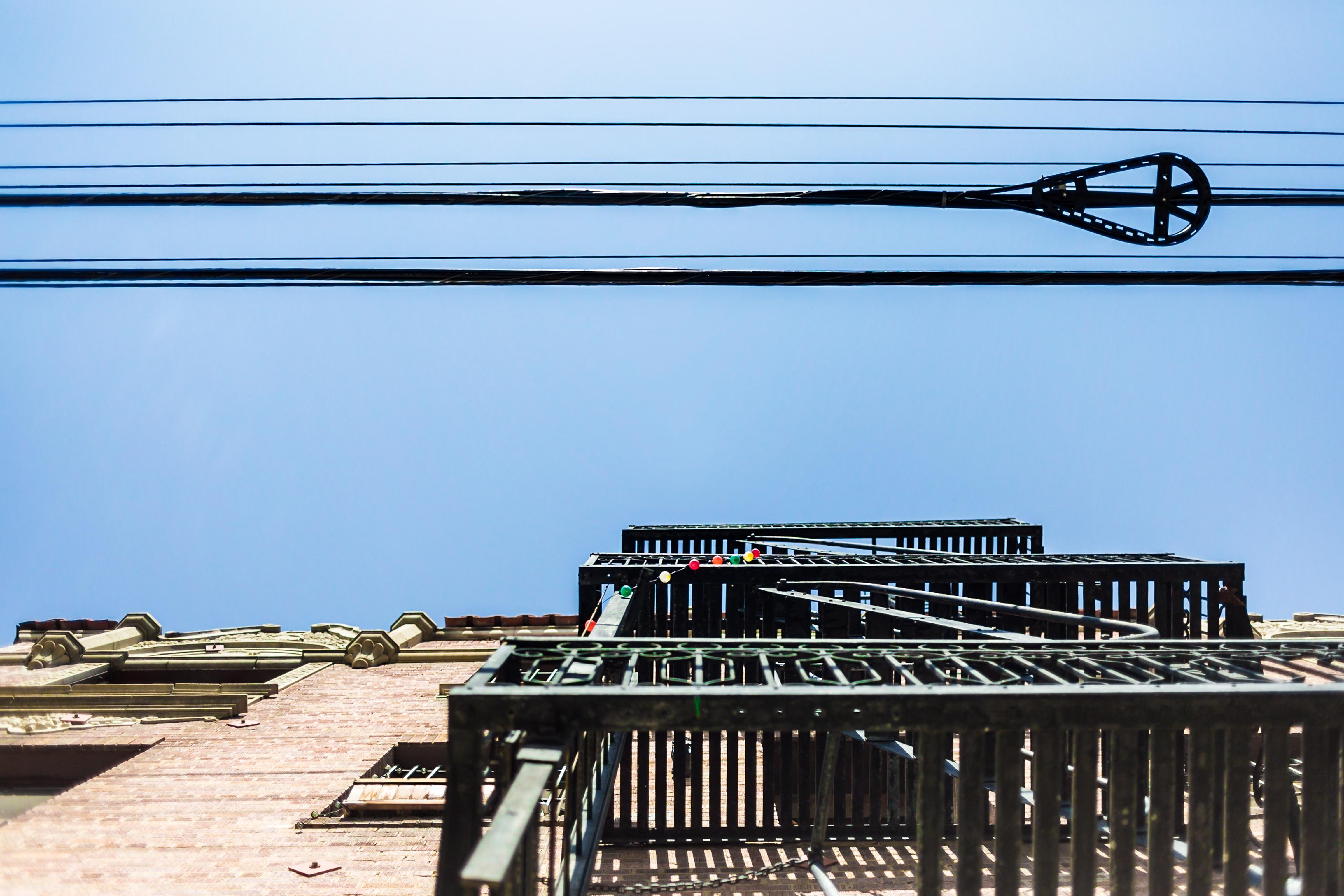 gray metal frames under black cables at daytime