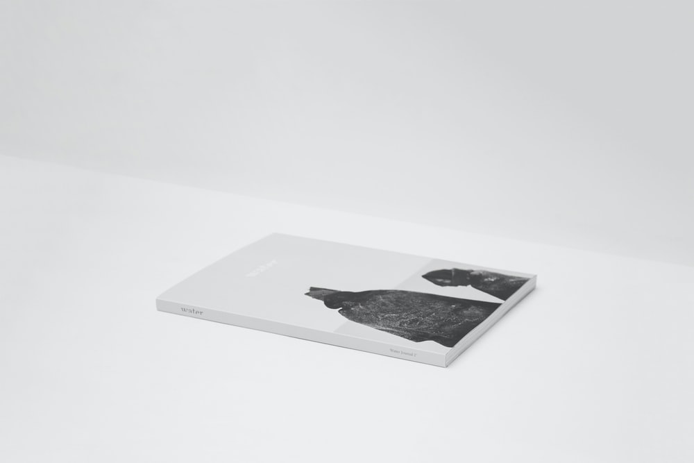 book on top of white surface