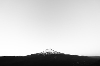 Mount Hood against white sky