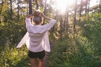 woman standing on the forest at daytime