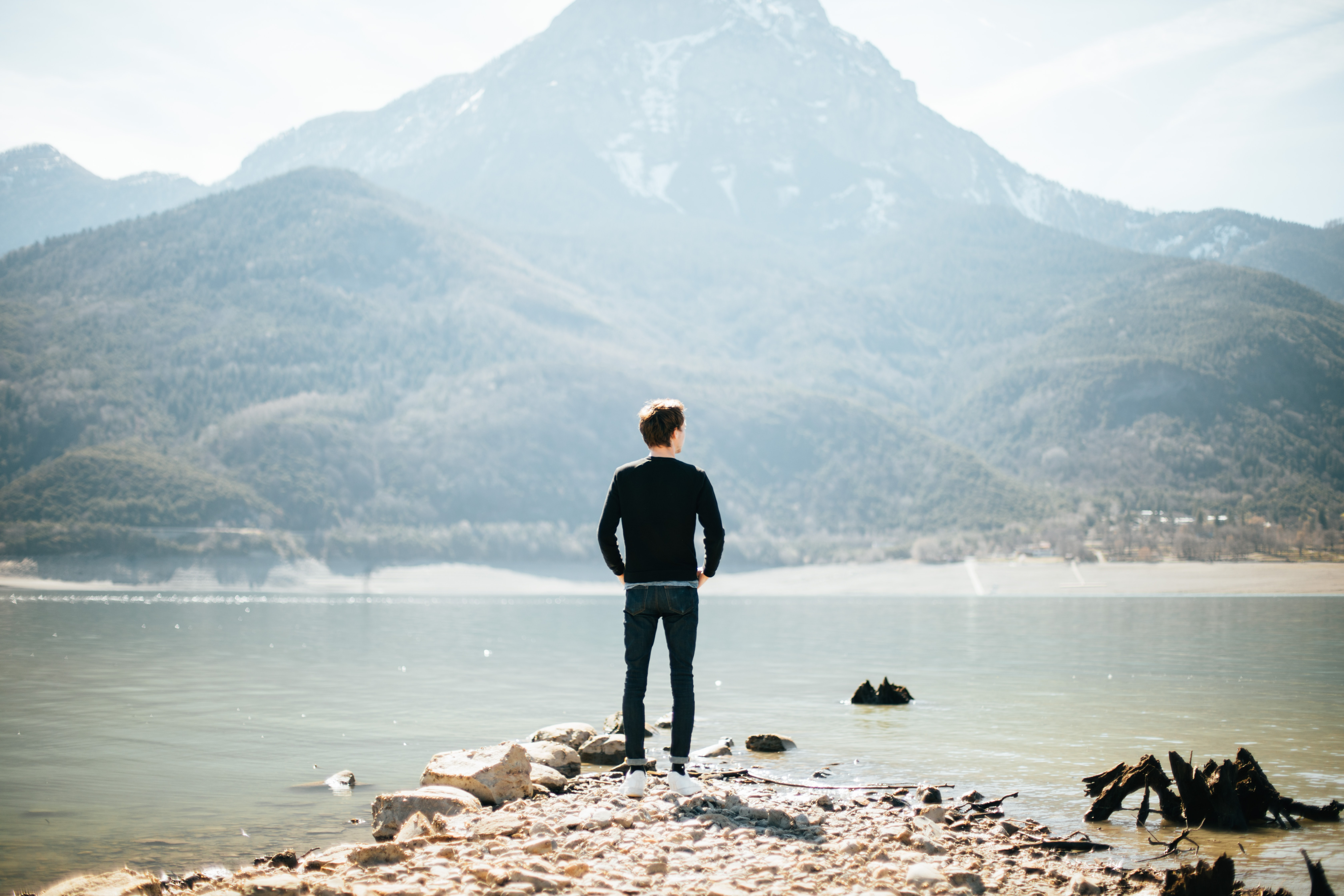 man standing on front of lake at daytime