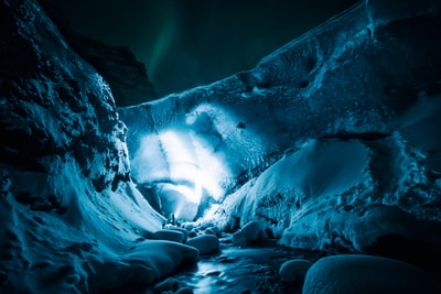 Night exploration of the ice cave. Tourists come to check this glacier and icecave in the daytime, which means nobody is around at night.  This time i was also lucky and northern lights were turned on. Unluckily the wind was strong and it blew snow all around from the glacier…also on the camera and lens (which can be seen on the top part of the picture..3 circles). White balance was set on cloudy, so blue came out. There was some tweaking of the exposure, shadows and clarity, but mainly this is it. Looks like a fairy-tail. Thank you Tomas, for pressing the button on the camera :) .