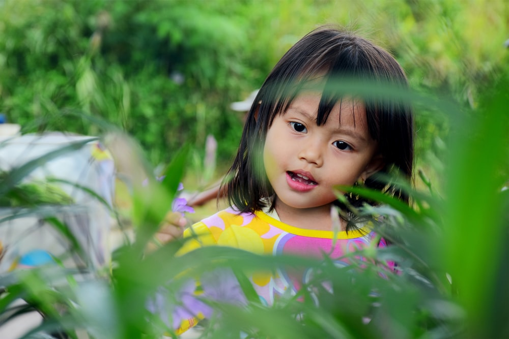 girl surrounded by plants