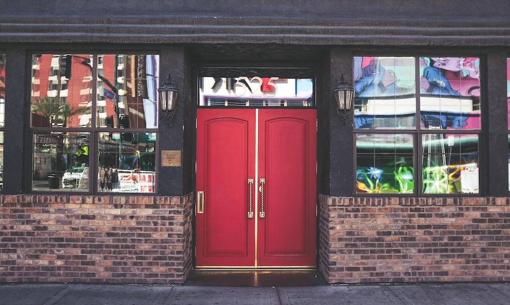 red wooden panel doors