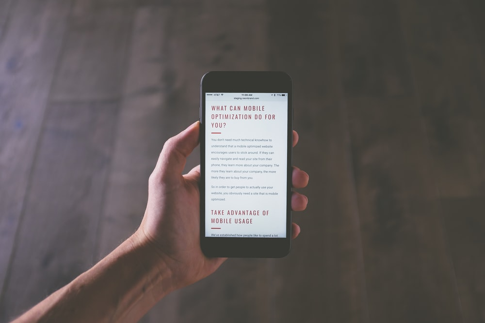 A person reading an article about mobile optimization on a smartphone